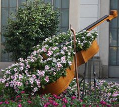 How about this, Old Bass Fiddle becomes a container for beautiful flowers. This is just out of this world!! I do love it in the flower bed too!!