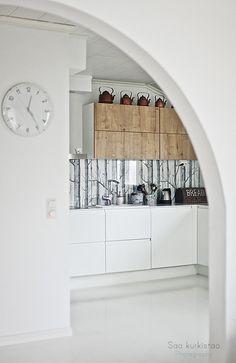 woods wallpaper backsplash + wood and white kitchen cabinets