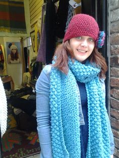 red crochet cloche is offset with a crochet rose pin to make a great team up with blackberry handknit scarf...scarf by edelmacbride and hat from the Knitfield pattern range