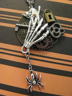 HALLOWEEN STEAMPUNK NECKLACE  Zombie Hand Cat by ZivaKreations, $24.25 Steampunk Halloween, Spooky Halloween, Halloween Themes, Halloween Party, Steampunk Necklace, Jewelry Crafts, Washer Necklace, Jewelry Making, Trending Outfits