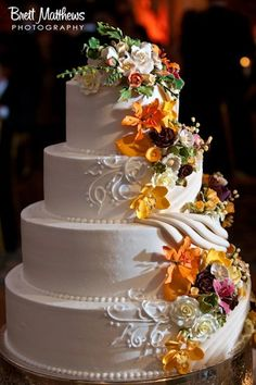 Love the idea of floral decorations trickling down the side of your wedding cake.