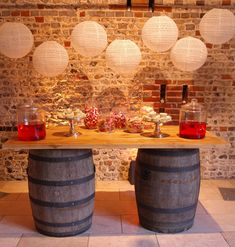 Lace hanging lanterns hung above our rustic barrel bar for a cake and sweet table for a rustic barn wedding at Upwaltham Barns by www.stressfreehire.com #venuetransformers