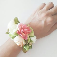 Silk flower bracelet | wrist corsage of coral, green and gold | bridesmaids' and family wrist corsage by LilySarah on Etsy https://www.etsy.com/listing/238412435/silk-flower-bracelet-wrist-corsage-of