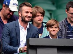 Like father, like son:David Beckham proved his love for all sports as he took his son Rom...