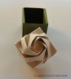 This is the famous Origami Rose Box by South Korean origami artist Shin Han-Gyo. You will need two sheets of square paper to fold the top and bottom of the box. Origami Rose Box, Origami Gift Box, Origami Star Box, Origami And Kirigami, Origami Ball, Origami Bookmark, Origami Folding, Paper Crafts Origami, Origami Hearts