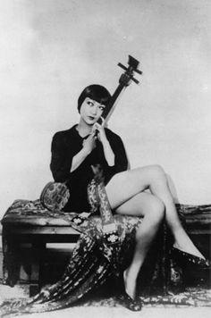 Actress Anna May Wong holding a shamisen.