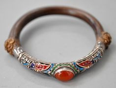 Mongolian bamboo bracelet with silver enamel front and carnelian stone. Early 20th century.