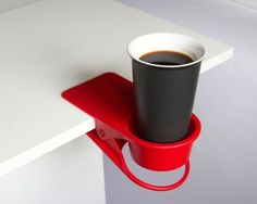 DCI DrinKlip Uni, Assorted Black, Blue, Red and White Colors by Decor Craft Inc / DCI. $16.14. Measures 4 by 8 by 2-1/2-inch. A smart extension for your space. Attaches to any desk, tabletop or shelf. Holds your drink, phone or other small items. Assorted black, blue, red and white colors (color is random and is chosen at the time of shipping). A smart extension for your space. The DrinKlip attaches to any desk, tabletop or shelf. Holds your drink, phone or other small items. Mea...