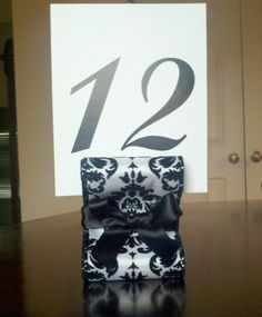 etsy: http://www.etsy.com/listing/91360437/wedding-table-number-holders-set-of-ten