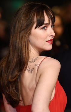 Dakota Johnson stole the show in a low-cut red slinky dress, baring all as she went braless to the star-studded event. (BAFTA - Feb. 2016)