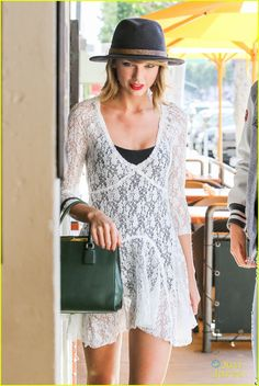 Taylor Swift opts for a white, lace dress and black hat during a sunny Wednesday afternoon (September 17) in Beverly Hills, Calif.