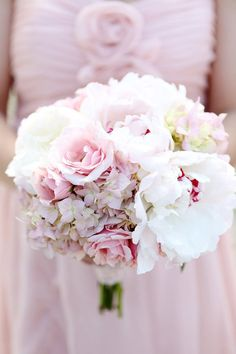 The bridesmaids bouquets will be clutches of blush pink hydrangeas, ivory spray roses, pale pink garden roses, and bits of green seeded eucalyptus wrapped in slate grey ribbon.