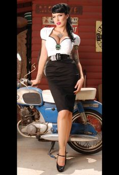 Pinup Fashion: such a fun black and white rockabilly dress. The skull accent is what makes it. Want!