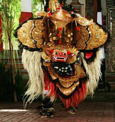 Barong dance in Bali Indonesia - imagine how hot and heavy this costume is for the two dancers underneath...
