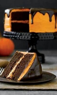 HALLOWEEN HORRORFEST - A cute Halloween cake-no link to recipe...just chocolate cake with orange buttercream and dark chocolate ganache