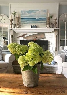 Fireplace decor ideas for those who love the sea. Some simple coastal and nautical ideas for your fireplace. Featured on Completely Coastal.