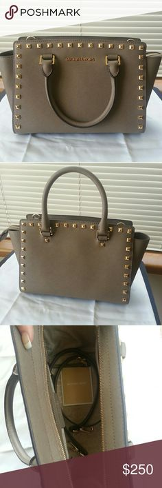 Michael kors medium studded selma Beautiful dark dune medium studded selma. Perfect condition, only used once. Bought the bigger size so want to sell this one. Has dust bag and long crossbody strap. Only minor scratches on metal feet. Michael Kors Bags Satchels