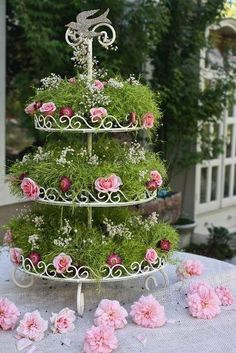 Dessert table idea. Layer of moss between the cake stand and the petit fours