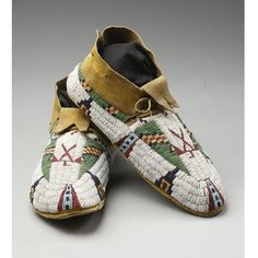 PAIR OF CHEYENNE PICTORIAL BEADED HIDE MOCCASINS each sinew sewn in ...