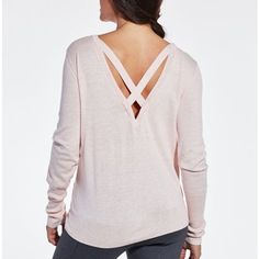 The CALIA™ by Carrie Underwood Women's Open Work Cross Back Sweater sweetens up your look with style. Soft, light fabric feels amazing next to your skin for total comfort, while a unique cutout design offers a subtle, fashionable look. The cross strap back design elevates the look even more and promotes breathability. Complete with ribbed sleeves for warmth, the CALIA™ Open Work Cross Back Sweater pairs perfectly with all your pieces.