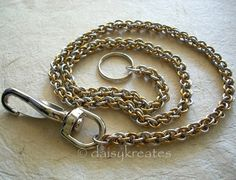 Thick links of jewelry brass and bright aluminum woven together in the intricate Jens Pink Linkage (JPL) pattern for this versatile wallet chain.  JPL is a type of spiraling chainmaille weave that req
