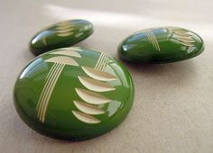 Carved Bakelite Buttons.