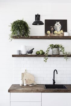 White tiles and wood shelves in the barn at The Bower, Byron Bay (luxury boutique design hotel).