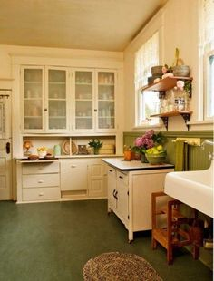 A very nicely done kitchen restoration using salvaged period elements. Wall cabinets are original. Green Marmoleum flooring and green wainscot lead the eye to original cabinets painted ivory, the focal point of the vintage kitchen. The low, freestanding c 1930s Kitchen, Old Kitchen, Kitchen Redo, Country Kitchen, Kitchen Remodel, Kitchen Dining, Kitchen Ideas, Vintage Kitchen Cabinets, Kitchen Floors