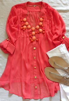 white jeans + long coral colored tunic + big necklace