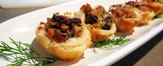Mushroom Mini Quiches  These freeze really well. Once the quiches are cooled, place in an air tight freezer container and separate layers with wax or parchment paper. To reheat, place the frozen quiches on a cookie sheet and bake at 350F for 10-15 minutes, until heated through.