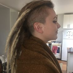 A dreadhawk hairstyle or mohawk dreads is a style which most commonly involves shaving both sides of the head, leaving a strip of dreadlocks in the centre. Partial dreads for females are often popular because they require less dreadlocks maintenance than a full set of dreads. My client chose to get dread extensions here as her hair was short and she wanted the two colour style. Dreadlock Styles, Dreadlock Hairstyles, Dreadlocks Pictures, Mohawk Dreads, Partial Dreads, Female Dreads, Dreadlocks Maintenance, Hair Type, Her Hair