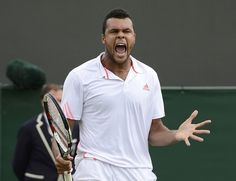 No. 5 seed Jo-Wilfried Tsonga screams during his fourth-round victory over Mardy Fish. Tsonga defeated Fish -- the last American man in the field -- 4-6, 7-6 (7-4), 6-4, 6-4.  DYLAN MARTINEZ / REUTERS