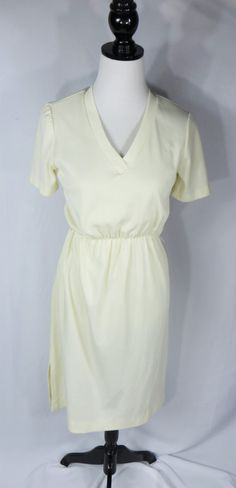 Cream Womens Dress is perfect for those days that you have nothing to wear. Kind find a thing that looks good on? Try this v neck dress that will