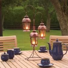 these little hanging lantern centerpieces are great; maybe vines or flowers up the stand.