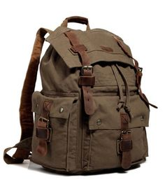 """Main Material:All canvas rucksack with leather straps.  Size:H:18"""" L:13"""" W:6""""  Interior: With a soft cotton lining and a large open compartment, this is yo"""