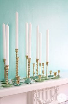 Bring boring brass candlesticks back to life with a little color. Inspired by Charm dips candlesticks in shades of green paint for a customized look.