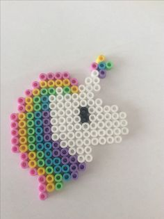 Hama bead Rainbow unicorn 18x15. Bead count 70 white 21 pink 19 yellow 16 green 15 blue 13 purple 2 black                                                                                                                                                                                 More
