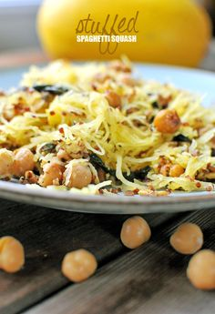 Quinoa, Spinach, & Chickpea {Stuffed Spaghetti Squash} | Nosh and Nourish #MeatlessMonday