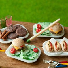 Classic Cookout The Artist: Caroline McFarlane-Watts, Hummingbird Miniatures  This spread of traditional American fare proves that bigger isn't always better in the U.S.A. The cheeseburgers are just 1.1 cm tall and the hot dogs are 1.4 cm long.