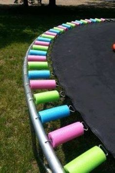 Pool noodles cut up to fit the springs on your tramp. So cheap and easy with no more pinched fingers!