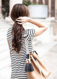 Stripes and a tasselled bucket bag.