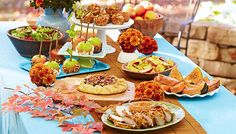 Picnic table set with apple-theme dishes