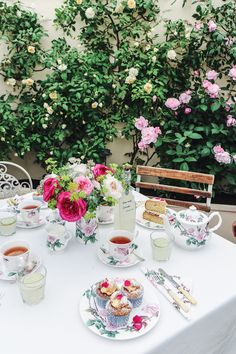 A tea table surrounded by David Austin roses