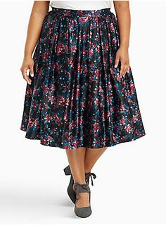 """Flirty and feminine, this skirt keeps you in a swing state. The tulle-on-tulle underlay lends major flare, while the midi length lends coverage. The black sateen overlay saves on water with a gorgeous rose print that has a bit of throwback appeal. Zip back keeps it fitted.<div><ul><li style=""""LIST-STYLE-POSITION: outside !important; LIST-STYLE-TYPE: disc !important"""">Size 14 measures 30"""" from center front</li><li style=""""LIST-STYLE-POSITION: outside !important; LIST-STYLE-TYPE: disc…"""