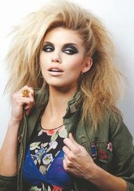 Big hair allover, one side pinned up, dark eye makeup - I would wear this for real!