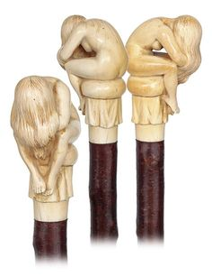 """. Ivory Nude Cane -Circa 1890-Seated nude study carved of a single piece of fine grained ivory, wild cherry branch shaft of a beautiful and rich natural color and a metal ferrule. The bashful girl was obviously granted the attention and skill that an artist gives to a selected creation and is imbued with great sensitivity. H. 3 ¾"""" x 2 ¼"""", O.L. 34"""""""