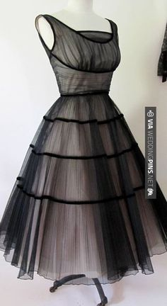 Wow - Vintage black dress. | CHECK OUT MORE GREAT BLACK AND WHITE WEDDING IDEAS AT WEDDINGPINS.NET | #weddings #wedding #blackandwhitewedding #blackandwhiteweddingphotos #events #forweddings #iloveweddings #blackandwhite #romance #vintage #blackwedding #planners #whitewedding #ceremonyphotos #weddingphotos #weddingpictures