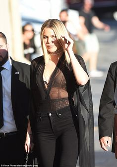 Super glam: Khloe Kardashian looked extremely sexy in a sheer black blouse that exposed her lacy bra as she headed to Jimmy Kimmel Live! in Hollywood on Thursday