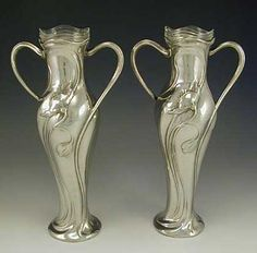 Pair of WMF polished pewter vases with original glass liners, decorated with poppies. Germany  c.1905  (hva)