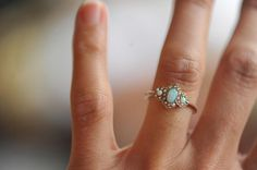 Opal and Pearl Victorian ring.    http://wedreamincolour.com/jade/lumen.003.php